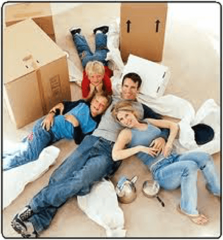 Long distance moving tips for parents -Family relaxing amidst boxes