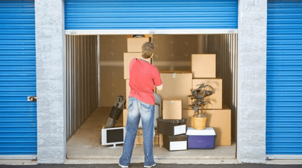 storage unit rules - man looking into storage unit